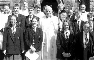Alan McCulloch,Wayne Shekleton , Archbishop Robin Eames, Jason Rowntree, Brian Gilmore and Stuart Patterson.(Front left-right) Roberta Rowntree, Samantha Madeson, Heather Worrell and Emma Sloan, Stuart Patterson, (Left) Alan McCulloch and Samantha Madeson who were confirmed by Archbishop Robin Eames in St. Nicholas's Church of Ireland.