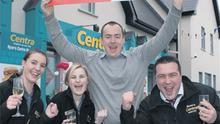 Emma McGuire; Amy Byrne; Daniel Hogan, store manager, and Patrick Ryan, of Ryan's Centra, Newport, Co Tipperary, celebrate after selling the winning Lotto ticket worth