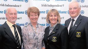 Fourth: Malone's Lesley Calderwood (second left) with Portsalon captain Donal Callaghan, lady captain Marie Gilligan and president Willie McClearly