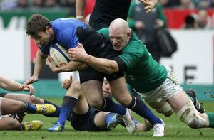 Irelands Paul O'Connell tackles France's Vincent Clerc (left)
