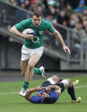 Irelands Tommy Bowe runs in to score a try