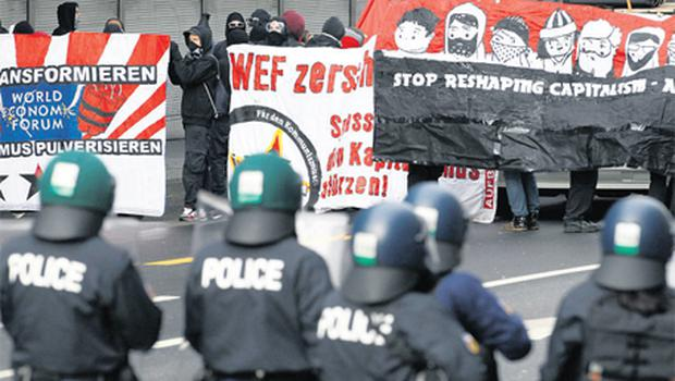 Swiss riot police monitor an anti World Economic Forum (WEF) demonstration in Bern at the weekend