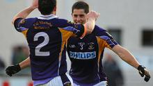 Kilmacud's Rory O'Carroll, right, celebrates with his brother Ross after yesterday's Dubiln SFC final at Parnell Park. Photo: Daire Brennan / Sportsfile