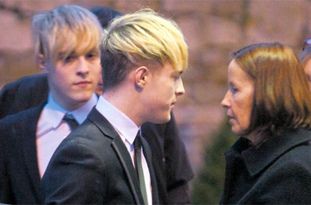 John and Edward Grimes talking to relatives at the removal for their grandfather