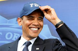 Obama sports a cap given to him by FBI chief, Robert Mueller