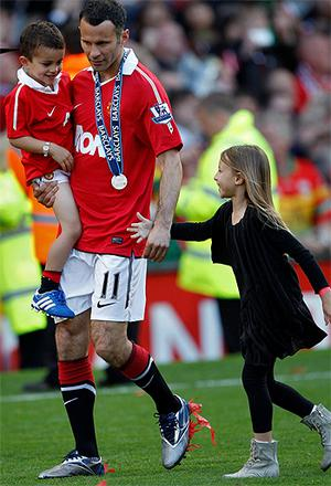 Ryan Giggs with his son Zach and daughter Libby on the pitch at Old Trafford. Photo: Reuters