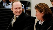 Mass killer Anders Behring Breivik smiles at his defence lawyer Vibeke Hein Baera during the second day of his terrorism and murder trial in Oslo