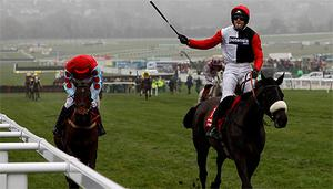Ruby Walsh on Big Buck's, right, celebrates after winning the World Hurdle