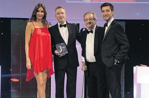 Host Lisa Snowdon (left) presents the Multiple Retailer of the Year Award to chief executive Noel Coyle, director Tony Obernik, joined by sponsor Ben Roberts (right) of Clogau Gold