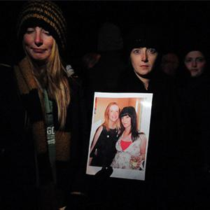 Aoife Phelan's sisters Nicole, left, and Lavina hold a picture of the missing woman at the vigil in Portlaoise