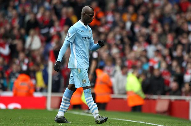 Mario Balotelli leaves the field after receiving a red card for a second bookable offence during the Barclays Premier League match at the Emirates stadium, London. Photo: PA