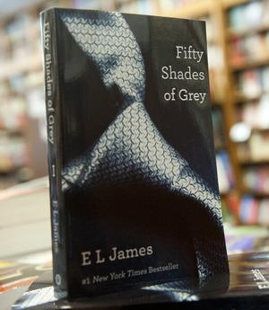 "Copies of the book ""Fifty Shades of Grey"" by E. L. James are seen for sale at the Politics and Prose Bookstore in Washington, DC, August 3, 2012. The first part of an erotic trilogy, the book has spent the past 22 weeks in the number one spot of the New York Times bestseller's list for fiction.     AFP PHOTO / Saul LOEB        (Photo credit should read SAUL LOEB/AFP/GettyImages)"