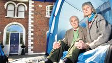 Brendan and Asta Kelly remain determined to camp outside their five-bedroomed Killiney home.