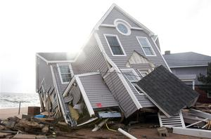 One of many homes badly damaged by Hurricane Sandy is pictured in the Cosey Beach neighborhood of East Haven, Connecticut. Photo: Reuters