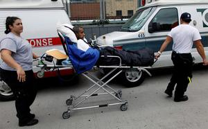 Patients being evacuated from the hospital. Photo: Reuters