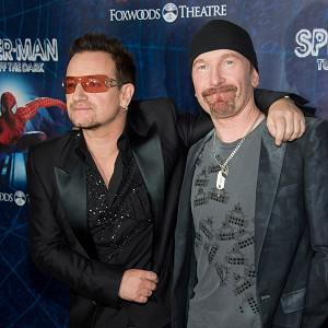 Bono, left, and The Edge arrive at the opening night of the Broadway Spider-Man musical