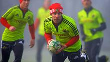 Tomas O'Leary, in action at Munster training yesterday, was one of the big losers in Declan Kidney's Ireland squad announcement - unlike team-mate Peter Stringer (left) who's one of two scrum-halves included by the head coach.