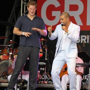 Prince Harry on stage with Brazilian singer Diogo Nogueir in the favella of Complexo do Alemao in Rio De Janeiro Brazil