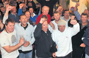 The rescued crew members celebrate at the Baltimore sailing club last night.