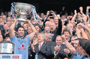 Dublin captain Bryan Cullen lifting the Sam Maguire Cup after defeating Kerry by one point in the All-Ireland Final