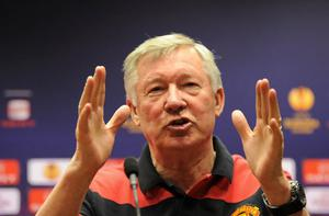 Manchester United' s coach Alex Ferguson gestures during a press conference