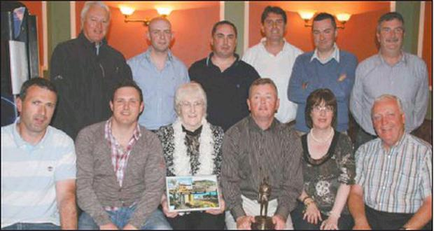 Colleagues honour Garda Eddie Grimes at his retirement party in Corkery's Bar, Millstreet. Included are front; Inspector Declan O'Sullivan, Garda Jonathan Griffin, Sheila McCarthy, Garda Eddie Grimes, Margaret Lehane, and Sergeant Gerry Carmody who...