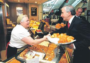 FG candidate Gay Mitchell with Maureen Kelly while canvassing in Blanchardstown Shopping Centre in Dublin yesterday