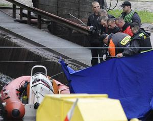 Police divers bring in a body found floating in a canal in Bydgoszcz, northern Poland, Wednesday. Officials say the documents of missing 21-year-old Irish soccer fan James Nolan were found on the body. Photo: AP