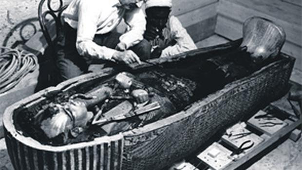Archaeologist Howard Carter at work on Tutankhamun's coffin in 1922