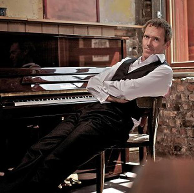 Hugh Laurie has signed a record deal at the age of 51