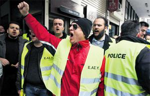 Policemen protest in Athens yesterday as they occupied their own social security fund building. The police fund has refused to participate in a voluntary bond swap, designed to lighten Greece's debt load by more than €106bn.