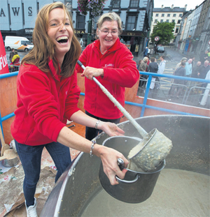 Ellen Flahavan (left) and Mary Flahavan stir the porridge pot at Waterford's Harvest Festival yesterday.