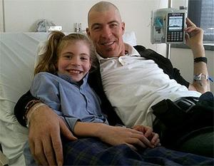 Jim Stynes with daughter Matisse as he receives chemotherapy
