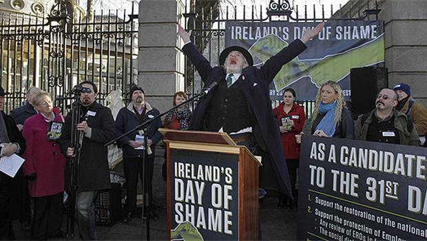 Actor Ger O'Leary re-inacts a speech by trade unionist James Larkin as a gathering of trade unions and community sector organisations protest against the cutting of the national minimum wage outside the gates of Leinster House. Photo: PA