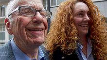 Rebekah Brooks and Rupert Murdoch pictured outside Mr Murdoch's London flat yesterday