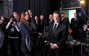 France's President Nicolas Sarkozy and First Lady Carla Bruni-Sarkozy wait backstage before appearing on French national television in Paris.