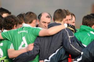 Fermanagh boss John O'Neill listens as trainer Simon Brady speaks to the players before the start of the game against Kilkenny last Saturday. Photo: Ray McManus / Sportsfile