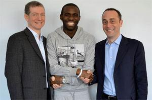 Bolton Wanderers footballer Fabrice Muamba (C) poses for a photograph with Dr Andrew Deaner (L) and Dr Sam Mohiddin in this undated photograph released by his premier league soccer club April 16, 2012.