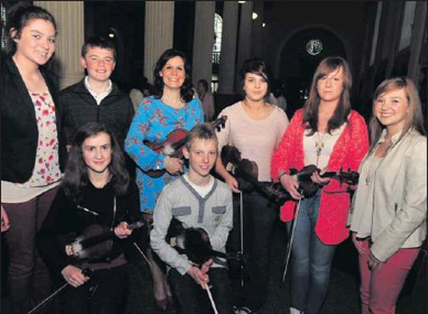 Some members of the Millstreet Strings group with director Emer Twomey looking forward to their recital in Drishane. Credit: Photo by John Tarrant