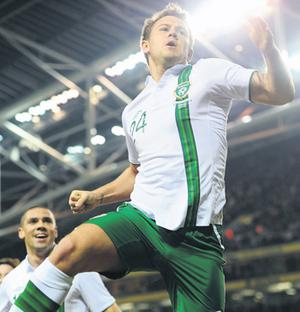 Simon Cox jumps for joy after scoring Ireland's late equaliser against the Czech Republic last night