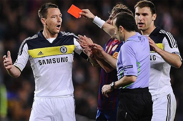 Marching orders: John Terry reacts with shock after being shown a red card. Photo: Getty Images