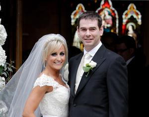 Bride Karen Woods and groom Sean Quinn Jr pose for pictured after their wedding ceremony at St Mochta's Church in Castleknock yesterday.Pic Frank Mc GrathPic Frank Mc Grath