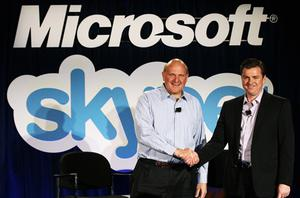 Microsoft CEO Steve Ballmer (left) and Skype CEO Tony Bates shake hands yesterday after Microsoft announced the $8.5bn take-over of Skype. Photo: Getty Images