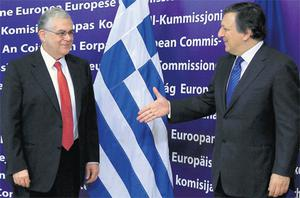 European Commission president Jose Manuel Barroso (right) with Greek Prime Minister Lucas Papademos yesterday