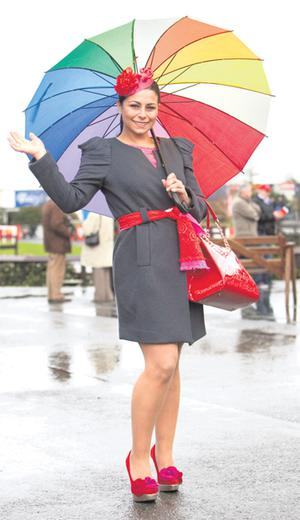 Eliana Fuscoe braves the rain to enjoy the day out at the Irish Grand National in Fairyhouse, Co Meath