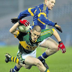 Kerry's Stephen O'Brien loses his footing while under pressure from Tipperary's Ger Mulhaire during the Cadbury Munster U-21 Football semi-final at Semple Stadium last night