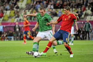 Fernando Torres, Spain, goes past the challenge of Richard Dunne. Photo: Sportsfile