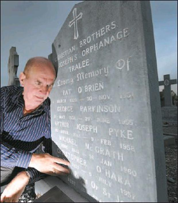 Tormented abuse victim John Prior sits by a stark headstone at Rath Graveyard in Tralee which bears the names of children that attended St Joseph's Industrial School. Credit: Photo by Domnick Walsh/Eye Focus