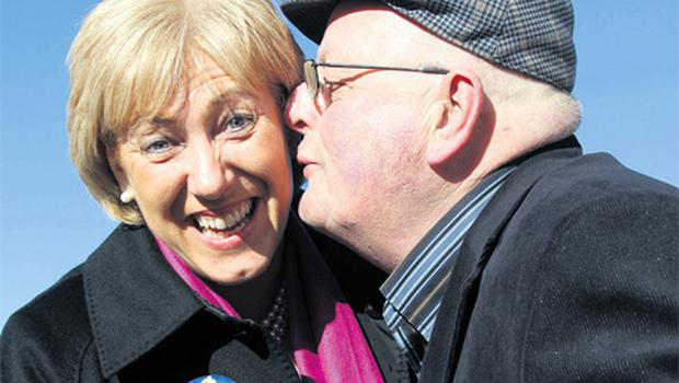 Heather Humphreys, Fine Gael candidate for Cavan / Monaghan gets a kiss from voter Tony Higgins in Cootehill