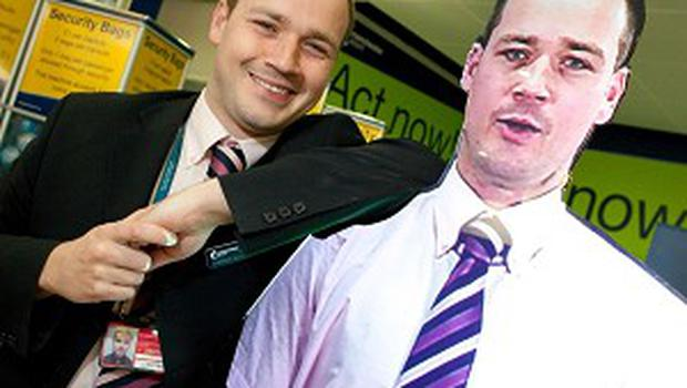 Manchester Airport employee John Walsh poses with a hologram of himself, which will greet passengers at security checks